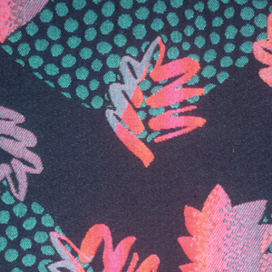 On a black ground, leaves in two sizes. Large leaves composed of turquoise dots, smaller leaves of pink and purple outlines and solids.