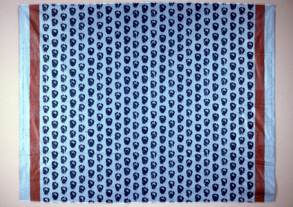 Blob-like shapes filling the fabric with a border stripe at each edge. Blue and red on blue ground.