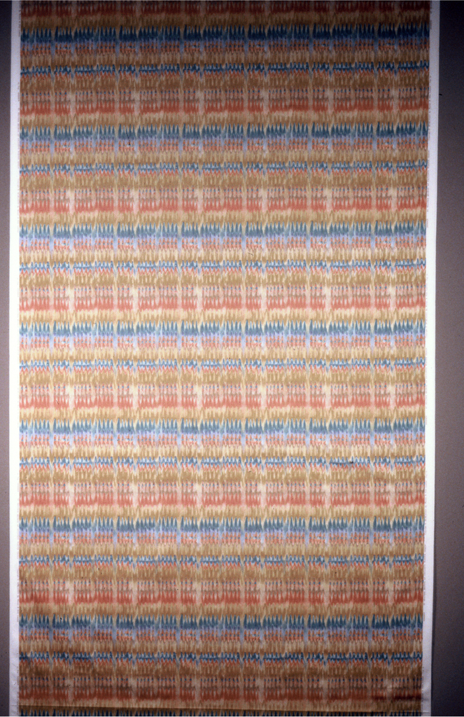 Undulating bands of color as if paint had been combed. Predominantly pinks, gold and blues. Width of pattern is 53 inches, leaving a margin at each side.