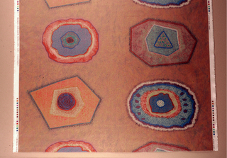 Ovals and geometric shapes in orange, browns, golds, purples and blues printed on white.
