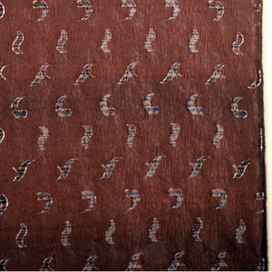 C- and S-curve motifs woven on a chocolate brown ground.