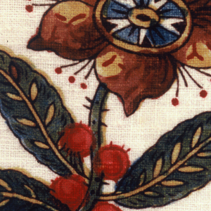 Two lengths of fabric have been joined to form this apron with a silk ribbon attached at the top covering the gathers. The pattern consists of four detached flowers. Each flower is repeated horizontally across the fabric with alternate rows offset.