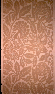 In one flat shade of mauve on pink, geometricized sunflower, foliate medallion, pomegranate and carnation-like flowers and foliage joined by sinuous vines.