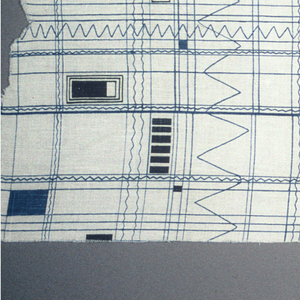 Non-directional pattern. Blue grid with black geometric shapes printed on undyed fabric.