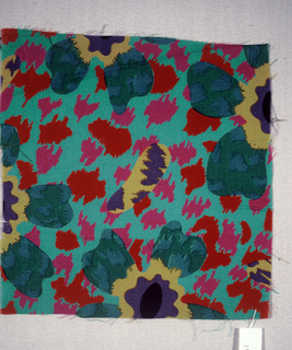 Green with stylized flowers in black, purple, yellow, green and blue.