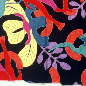 Black with stylized plants, birds and camels in red, purple, yellow, green and blue.