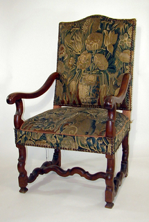 Open armed armchair, back and seat covered in tapestry attached via brass buttons, curvilinear legs and stretchers at base.  Chair's armrails depart from halfway up chair-backs, dipping and swinging outwards.