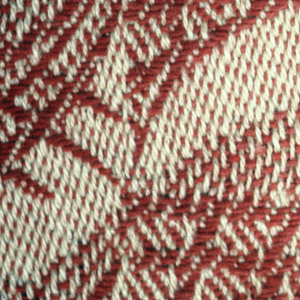 Red and off-white pattern of interlacing lines forming curves.