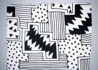 White with black abstract print.