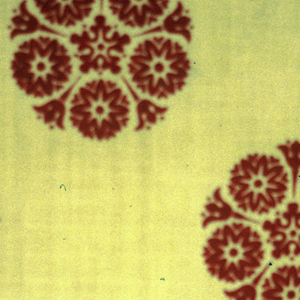 Red circular rosettes on a strong yellow ground. Mark at one end.