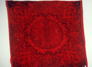 Central medallion of an 8-lobed shape surrounded by a massed border. In black on red.