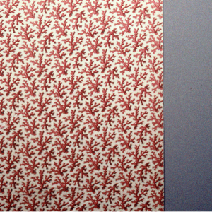 Overall pattern of coral branches surrounded by dots in two reds and brown. Fabric has original glaze.