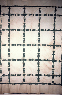 "Large, unquilted patchwork cover with bands of printed cotton in ""flying geese"" pattern alternate with plain wite cloth."