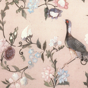 Flowering branches and scrolls in polychrome on a tan background. Two birds in center sitting on branches. One bird painted in grey with a red eye, the other light blue, brown and yellow with spots of bright red.