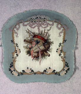 Tapestry weave seat cushion in a curvilinear shape with an ivory field and light green border. Central musical trophy is framed by C and S-curve cartouche with roses and ribbon, in the Rococo Revival style.