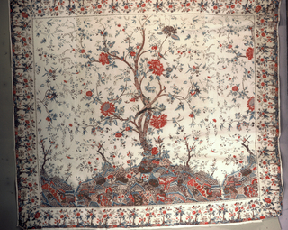"Large square or ""mezzaro"" in a design of a hillock and a large-scale tree in the central panel with surrounding animals and birds. Border has flowers and small trees. In blue, red, brown, magenta and black."