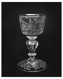 Short, wide chalice, engraved with Asia, holding a bow; Europe with cornucopia and banner with the coat of arms of the House of Habsburg and the eight Electors; Africa in sun hat, seated on crocodile; America with feather skirt and headdress, arrow and coral, attended by elephant. Baluster stem with circular cut, and air bubble. Foot engraved with flowers.