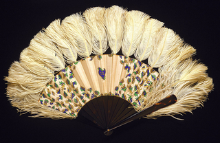 """Pleated fan. Painted and gilded silk leaf with scattered ornaments and central initials """"IZ"""". Tortoise sticks, possibly imitation, with ostrich feathers. Gilt metal rivet engraved with initials."""