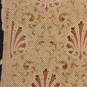 Repeating anthemian or palmette motif, printed in rows, in red, on tan background patterned with scrolling acanthus leaves.
