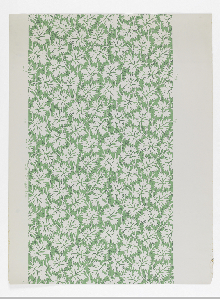 All-over design of white grape leaves on green ground.
