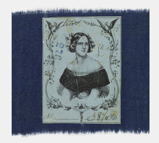 Small piece of blue fabric printed with with a black allover sprig-like design. The reverse has a sticker with the Swedish opera singer Jenny Lind. She first came to the United States in 1850 at the invitation of the showman P. T. Barnum.