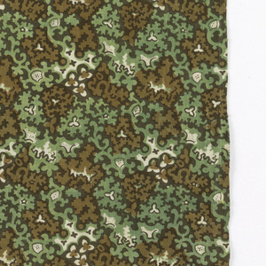 Brown, green and black on a white ground in a close allover pattern of leafy sprigs and scrolls.