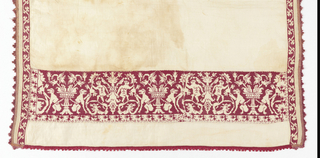White linen towel with narrow border design of conventionalized vine embroidered in red silk using cross-stitch, and two end bands embroidered with deflected element work showing symmetrical grotesque design of monkeys, dolphins, swans and figures in red silk thread. Red silk fringe on all four sides.