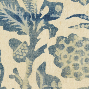 Fragment in two shades of blue on a white ground. Design of oak branches with acorns and leaves. Large owl perched on branch at the left. Pineapple and foliage at right.