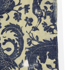 Dark blue resist print on a white ground. Design shows serpentine branches with ornamental foliage and perching bird. White dots used to suggest detail in the foliage and on birds.
