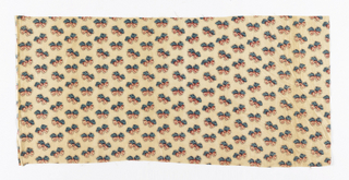Cream-colored cotton roller printed with an al-lover pattern of pink and blue bows with scattered black dots.