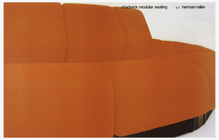 Poster depicts a cropped close-up view of a bright orange couch. Above, in black ink: chadwick modular seating [logo] herman miller.