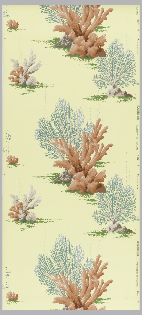 Bathroom paper. Green and coral colored coral with tan and metallic silver on a yellow ground.