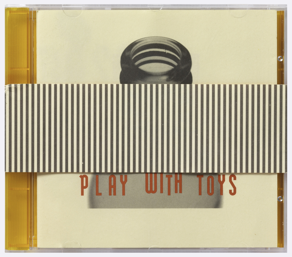 Sleeve:  inside has orange and cream vertical stripes' outside has gray and cream vertical stripes.  Case:  two-color jewel case in clear and orange.  Insert:  cream background with image of a gray glass bottle, BASEHEAD/PLAY WITH TOYS is centered over the image in red.  CD:  alternating red and silver concentric circles.