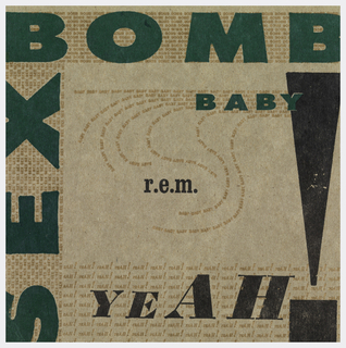 "Green, gold, and black, inks on cardboard packaging.  on right border ""SEX"" in bold green fron surrounded by smaller ""sex"" words repeated in gold font.  On top border ""BOMB"" in bold green font surrounded by smaller ""bomb"" words repeated in gold font.  At center right ""BABY"" in green font surrounded by smaller ""baby"" words in gold font in swirling pattern.  On bottom of cover""YEAH!""  in black font surrounded by smaller ""yeah"" words in gold font.  At center ""r.e.m."" in black font."