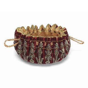 Purse of red velvet  embroidered in silver metal yarns in a design of conventionalized floral forms radiating from center bottom. With a cream-colored silk satin lining and silk drawstring.