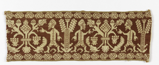 Design of trees with men (Assyrians?) standing in profile on either side. Design is probably earlier than the embroidery.