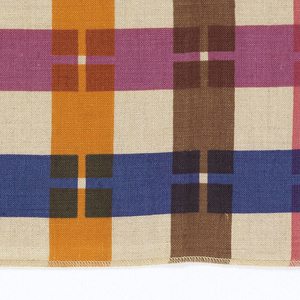 Interrupted stripes in vertical and horizontal directions. Printed in red, purple, blue, orange, pink, brown on natural color linen. Serged on all sides.