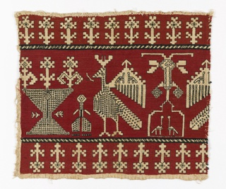 Border fragment showing geometric birds and plants in red and black silk on a linen ground.
