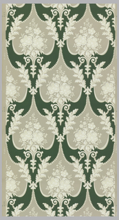 Grey medallions containing white and tan flowers bordered by leafy scrolls on a green background. Half drop repeat on a grey ground.