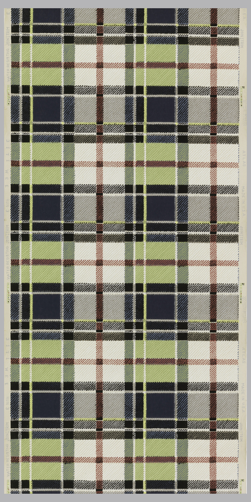 Simulation twill in a multicolored plaid of black, blue, grey, red, lime green, and white on an off-white ground.
