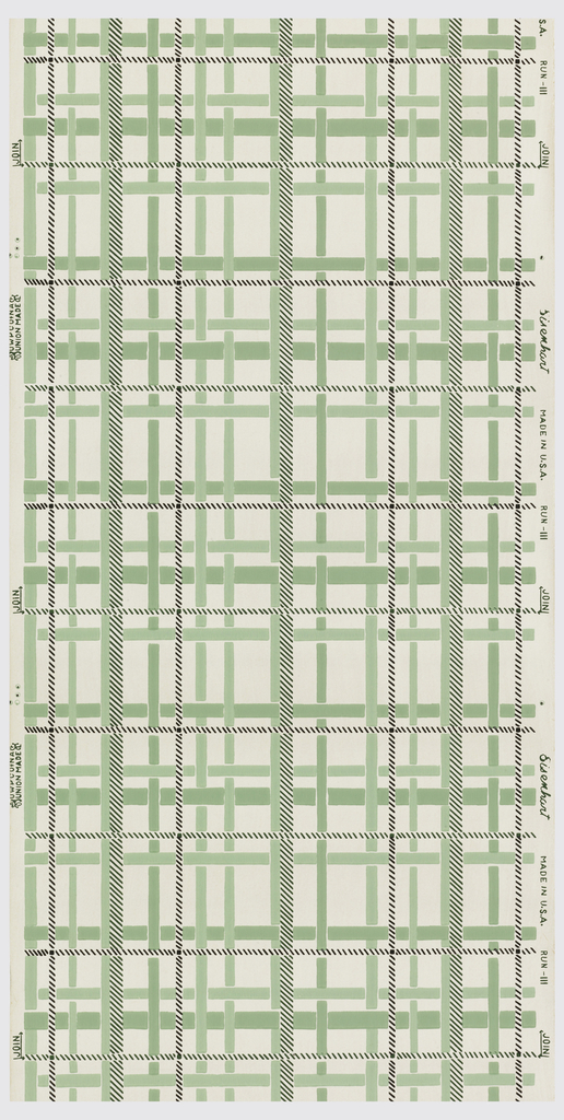 Plaid design of interwoven bands of greens and black in imitation twill on white ground.