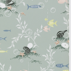 Bathroom paper. Underwater motif of pink, yellow, and blue fish swimming next to white and black seashells and coral. Metallic silver bubbles and highlights on a light turquoise ground.