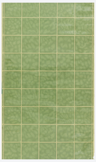 Green tiles on a beige ground with a varnished finish.