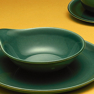 "Ceramic dinner ware in ""Seafoam"" color, consisting of a) cup, b) saucer, c) dinner plate, d) salad plate, e) dessert bowl, f) creamer."