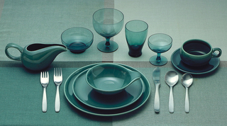 "Glassware in ""Seafoam"" color consisting of a) water goblet, b) cocktail glass, c) tumbler, d) dessert bowl."