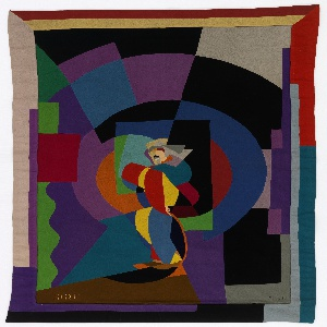"""Rectangular hanging showing an abstracted figure of a man in profile. Border of long overlapping rectangles. Cut and stitched from wool felt in a wide range of brilliant colors, brown, black and gray. Signature """"Fillia"""" in lower right corner in black thread stem stitch. In lower left corner """"S.I.R.E."""" in yellow stem stitch.  This patchwork hanging was designed by the Italian Futurist artist Luigi Colombo, who adopted the name Fillìa in the mid-1920s."""