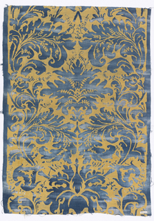 Block printed cotton  fabric in blue and green showing symmetrical design in the style of 15th century Venetian velvets.