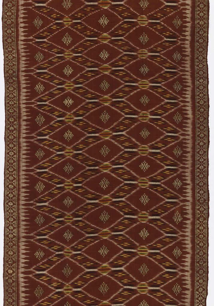 Long and narrow textile, probably a breast cloth (kemben), in red with green, purple, orange, and yellow. Borders fringed and heavily brocaded. Center design shows diamond-shaped lattice pattern with brocaded geometric florals.