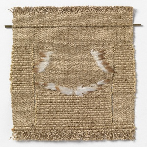 Small hanging in light brown with slits, inserted feathers, and fringe at top and bottom.