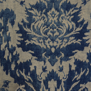 Silk textile printed with a feathery blue and tan pomegranate design and birds with long plumage.